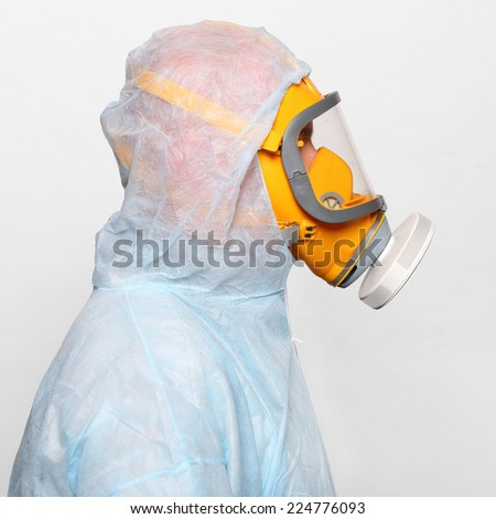 Man in protective clothing with respirator. Infection control concept. - stock photo