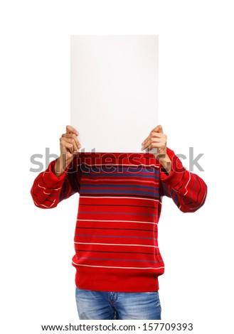 Man in red pullover shows presentation hiding his face isolated on white background - stock photo