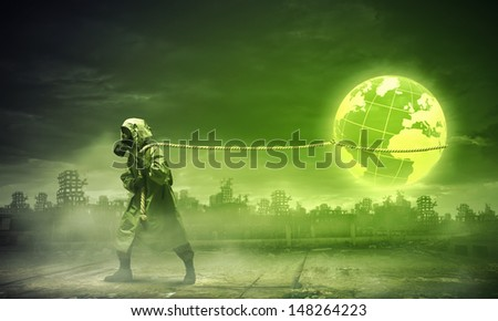 Man in respirator against nuclear background. Global pollution - stock photo