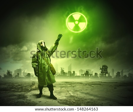 Man in respirator against nuclear background. Radioactivity concept - stock photo