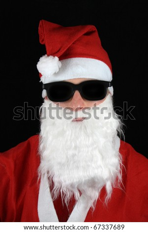 man in santa suit wearing dark sun glasses - stock photo