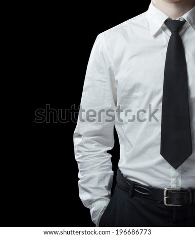 man in shirt on a black background - stock photo