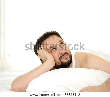 Man in sleeping bed, copy space up - stock photo