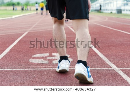 Man in start Track position - stock photo
