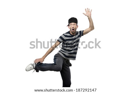 Man in striped shirt doing very expressive posing, white background - stock photo