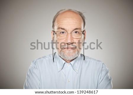 Man in studio looking at camera - stock photo