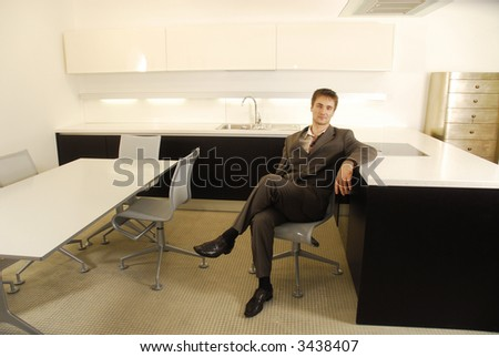 Man in suit in the modern kitchen - stock photo