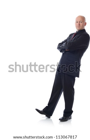 Man in suit leaning against something isolated on white - stock photo