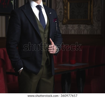 Man in suit posing in a bar - stock photo