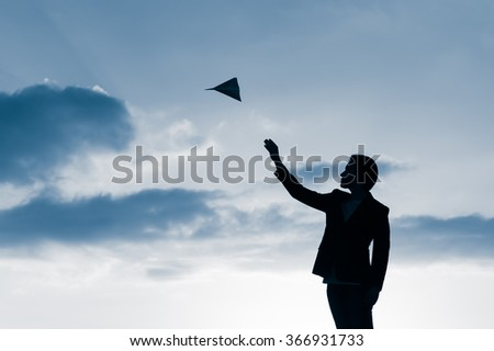 Man in suit throwing paper plane. (Achievement and success concept) - stock photo