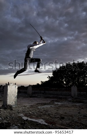 Man in suit with sword - stock photo