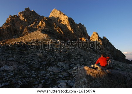Man in sunset on the lower saddle of the Grand Teton 11550' - stock photo