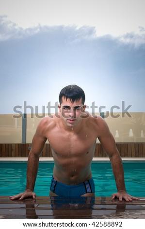 Man in swimming pool - stock photo