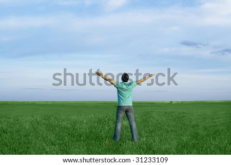 man in the meadow with dark blue sky - stock photo