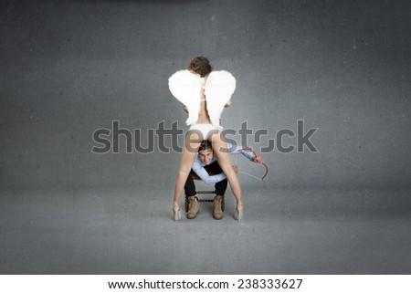 man in the middle of angel legs - stock photo