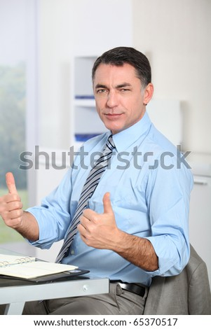 Man in the office showing positivity - stock photo