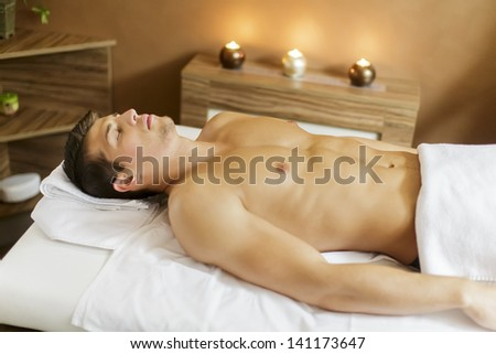 Man in the spa - stock photo
