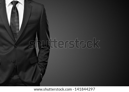 man in the suit on black - stock photo