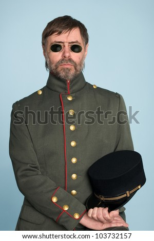 Man in the uniform of a military officer in the pince-nez. - stock photo