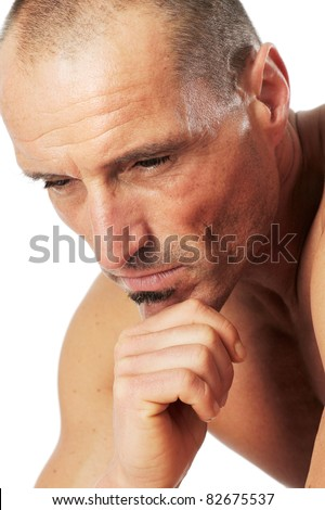 Man in thinker pose, portrait. Close-up against a white background. - stock photo