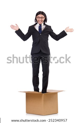 Man in thinking out of the box concept - stock photo