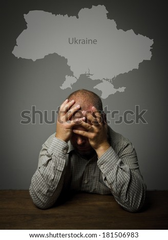 Man in thoughts about the future of Ukraine.  - stock photo