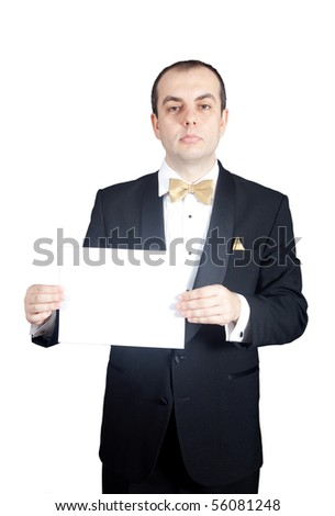 Man in tuxedo holding blank piece of paper - stock photo