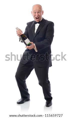 Man in tuxedo with a bottle of champagne winning - stock photo