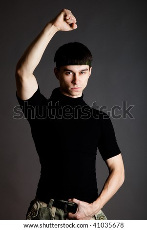 Man in uniform on gray background - stock photo