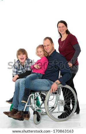 man in wheelchair with family - stock photo