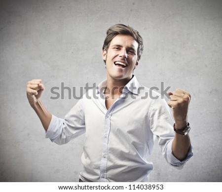 Man in white shirt rejoicing - stock photo
