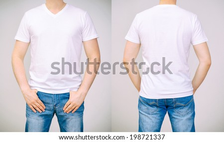 Man in white t-shirt. Grey background. - stock photo