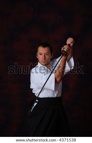 Man in white with sword - stock photo