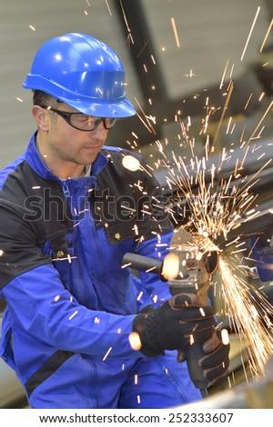 Man in workshop manufacturing metal - stock photo