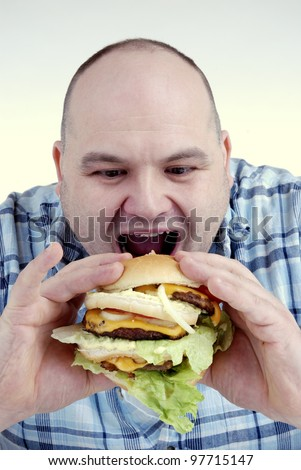 man is about to eat a big cheeseburger - stock photo