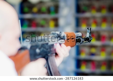 Man is aiming a gun in the shooting-range - stock photo