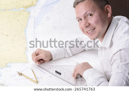 man is drawing on navigation map - stock photo