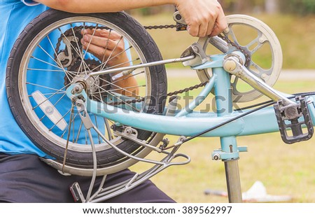 Man is fixing bicycle - stock photo