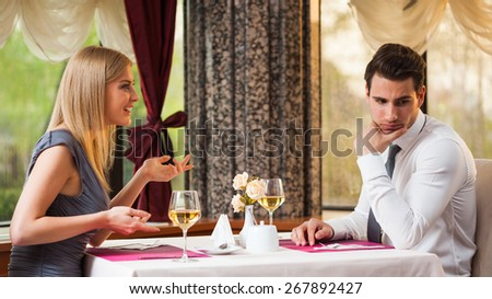 Man is getting bored on first date - stock photo