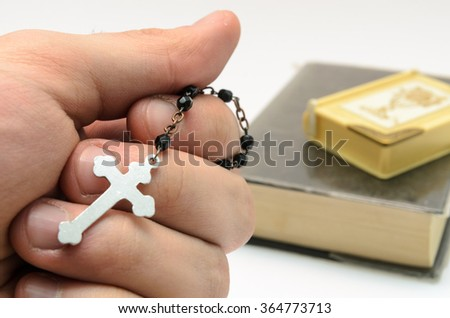 man is keeping rosary beads in his hand - stock photo