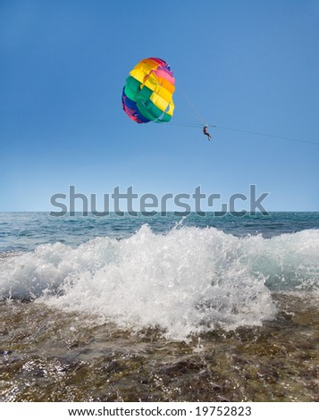 Man is para sailing in the blue sky - stock photo