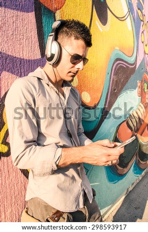 Man is relaxing with his phone and music in the city - stock photo