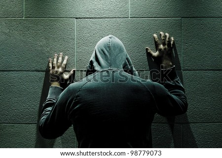Man is reviving his past isolated in dark room./Regret - stock photo