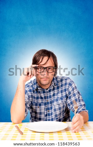 Man is seriously hungry - stock photo