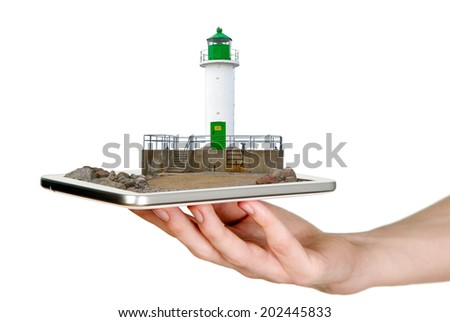 Man is showing white lighthouse with green details - stock photo