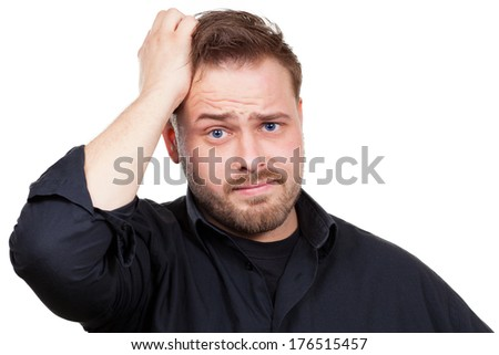 Man is stressed and is looking for an idea - stock photo