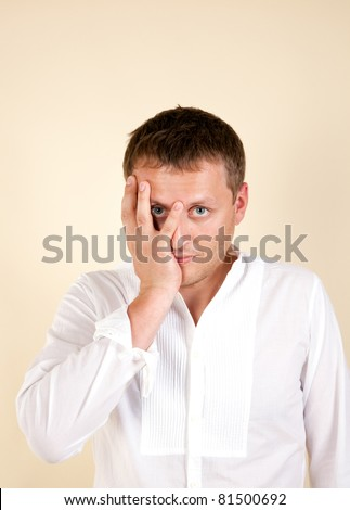 man is under stress and keeps the head on his hand - stock photo