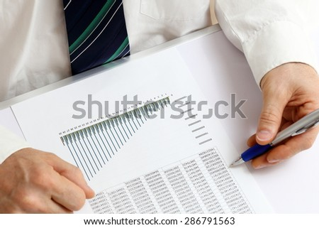 man is writing on a office dicument - stock photo