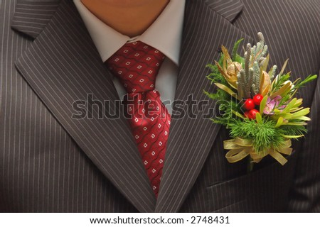 man jacket with corsage with red tie - stock photo