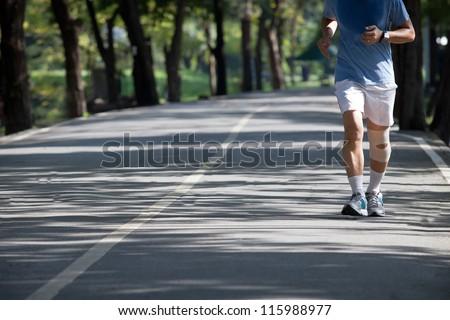 man jogging in the public park - stock photo